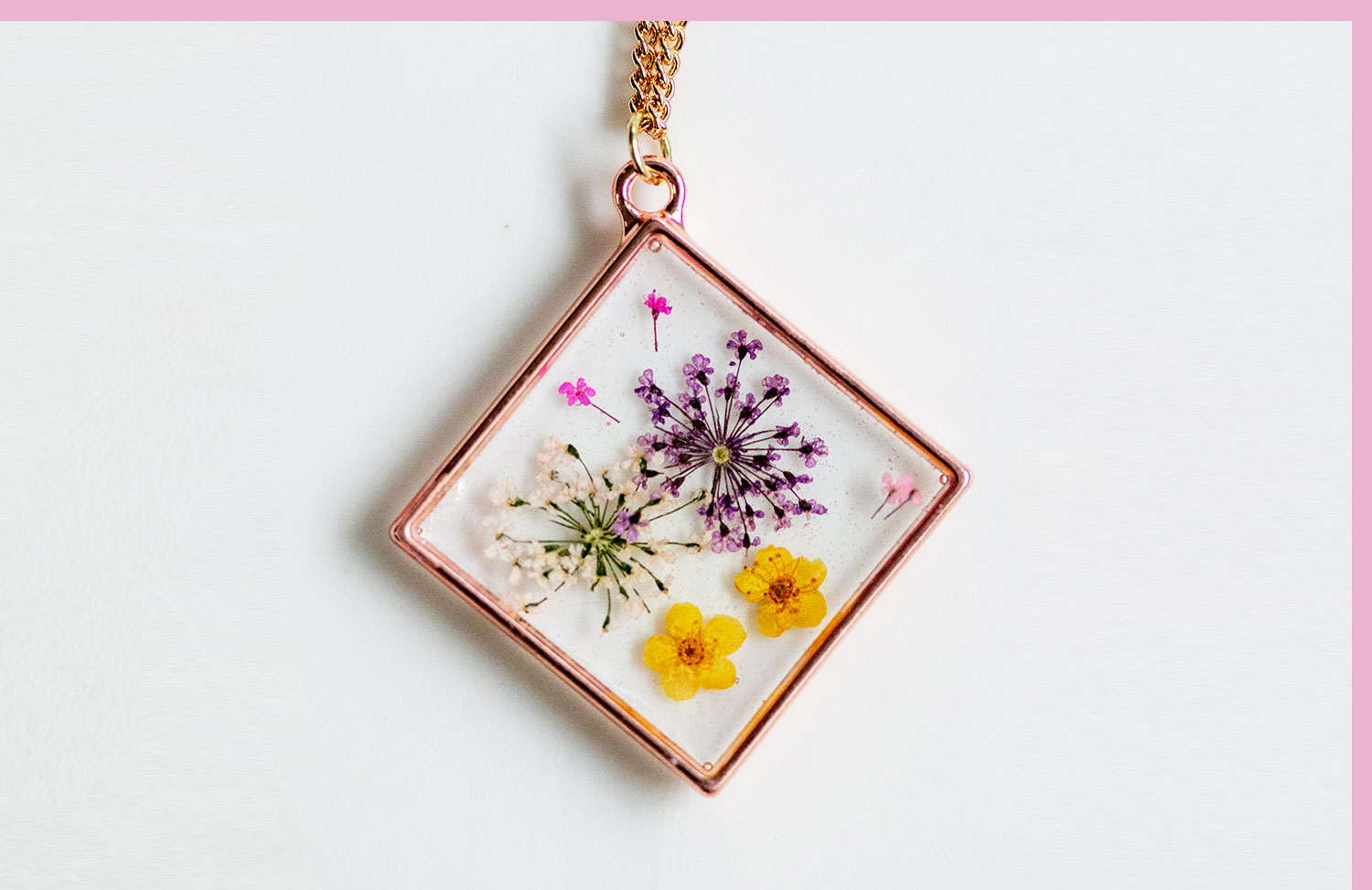 flowers pressed into a pendant necklace