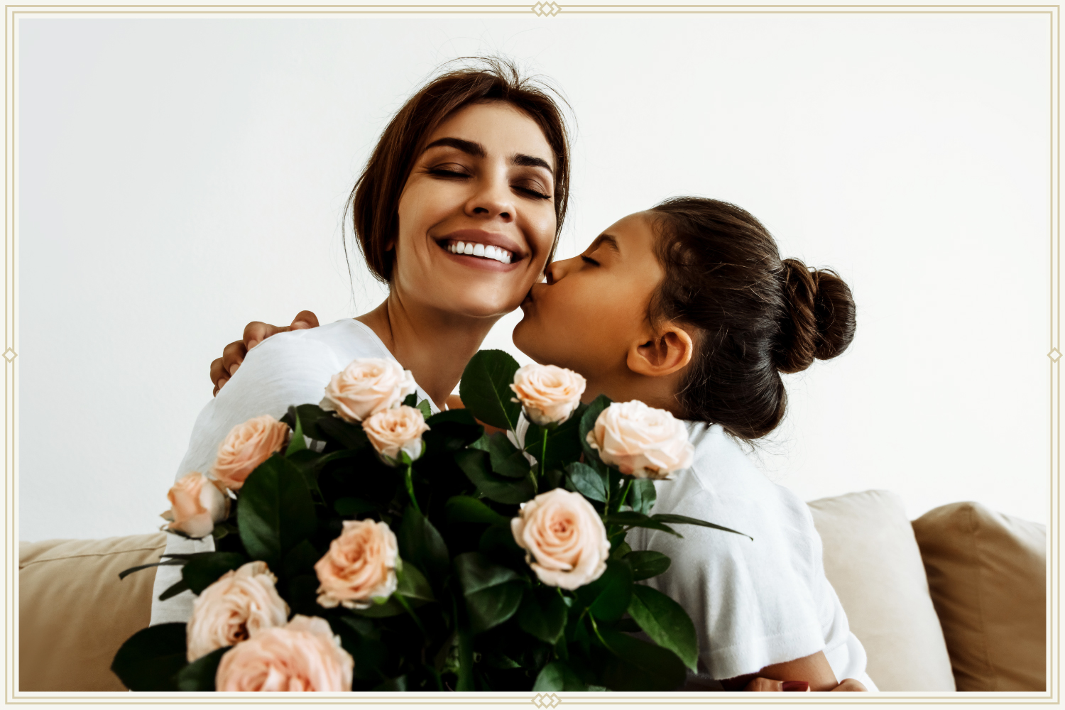 daughter giving mother a kiss while holding bouquet of roses