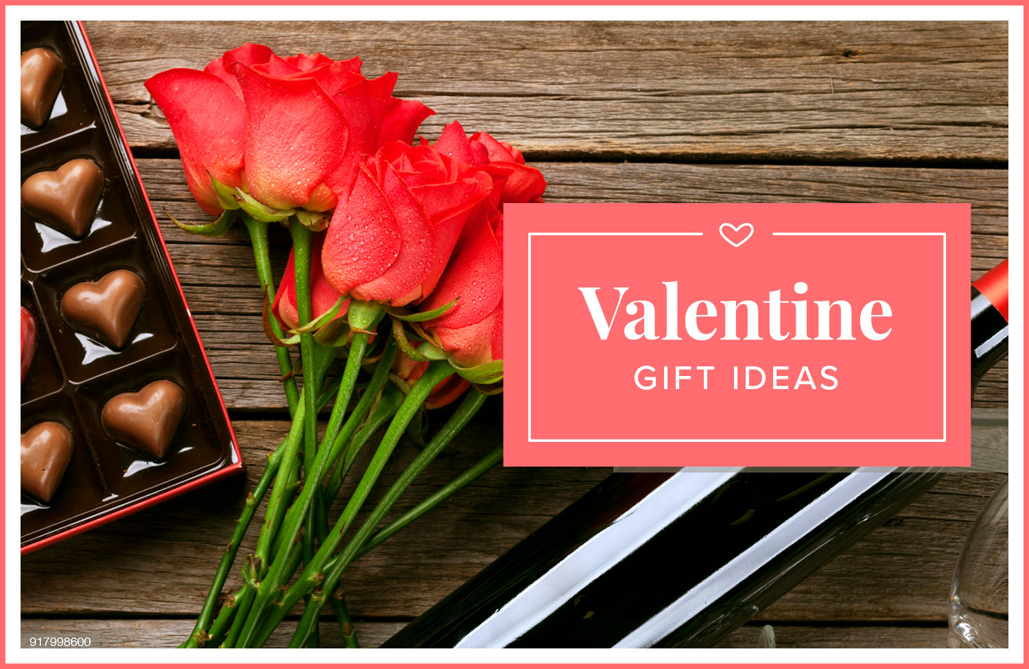 photo of roses and chocolates on a wood table