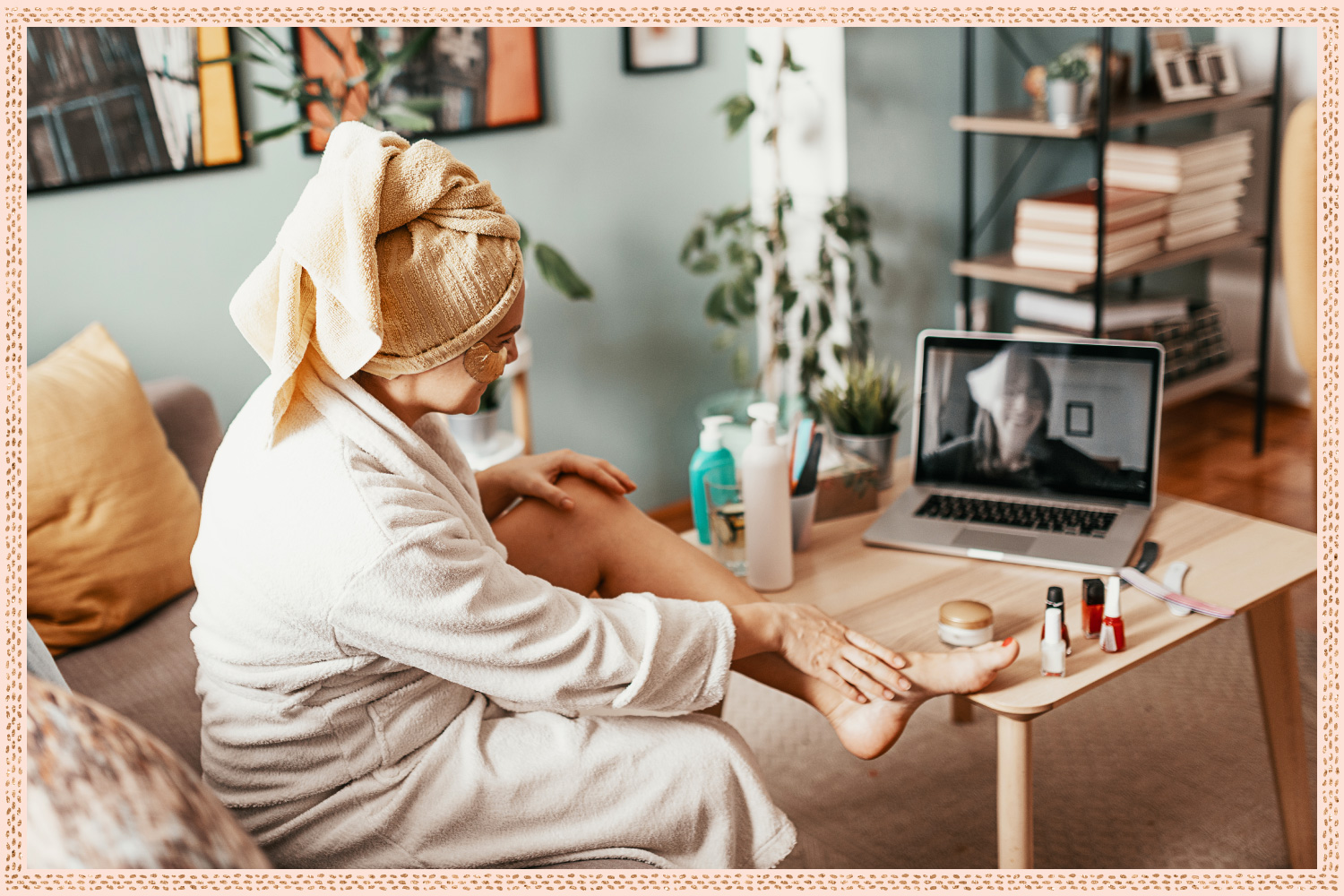 woman with towel on head and face mask on video chatting her friend on her laptop