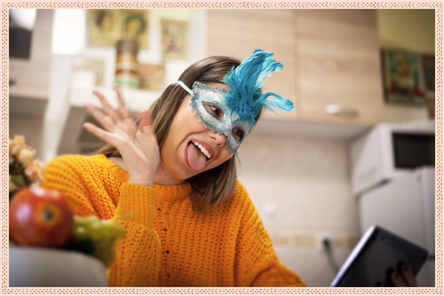 young woman with mask on sticking out her tongue and waving at tablet