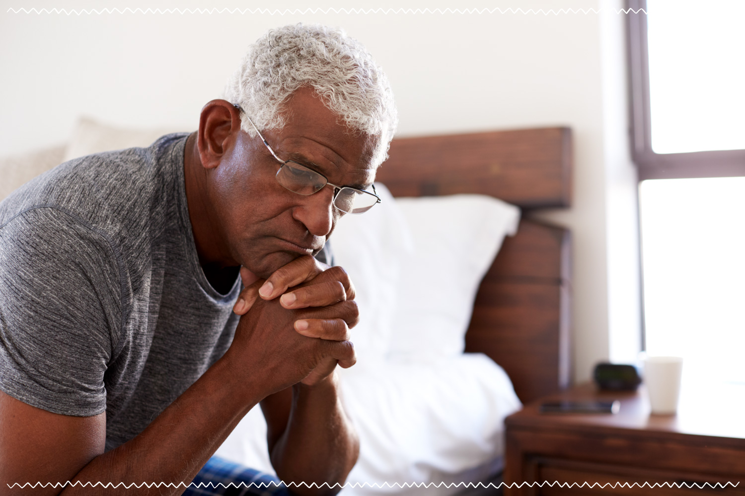 elderly man alone in bedroom grieving