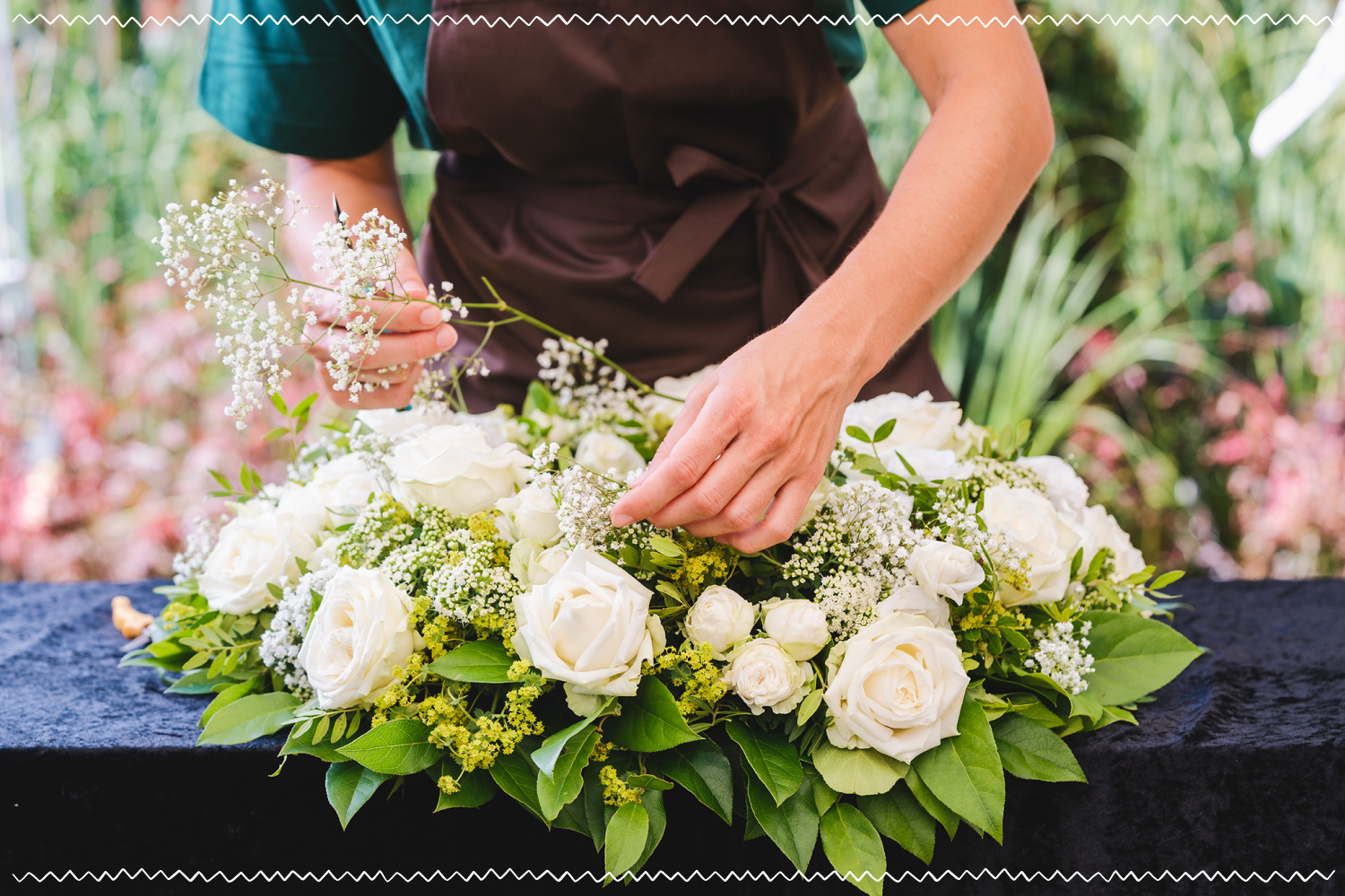 florist arranging a bouquet of white flowers