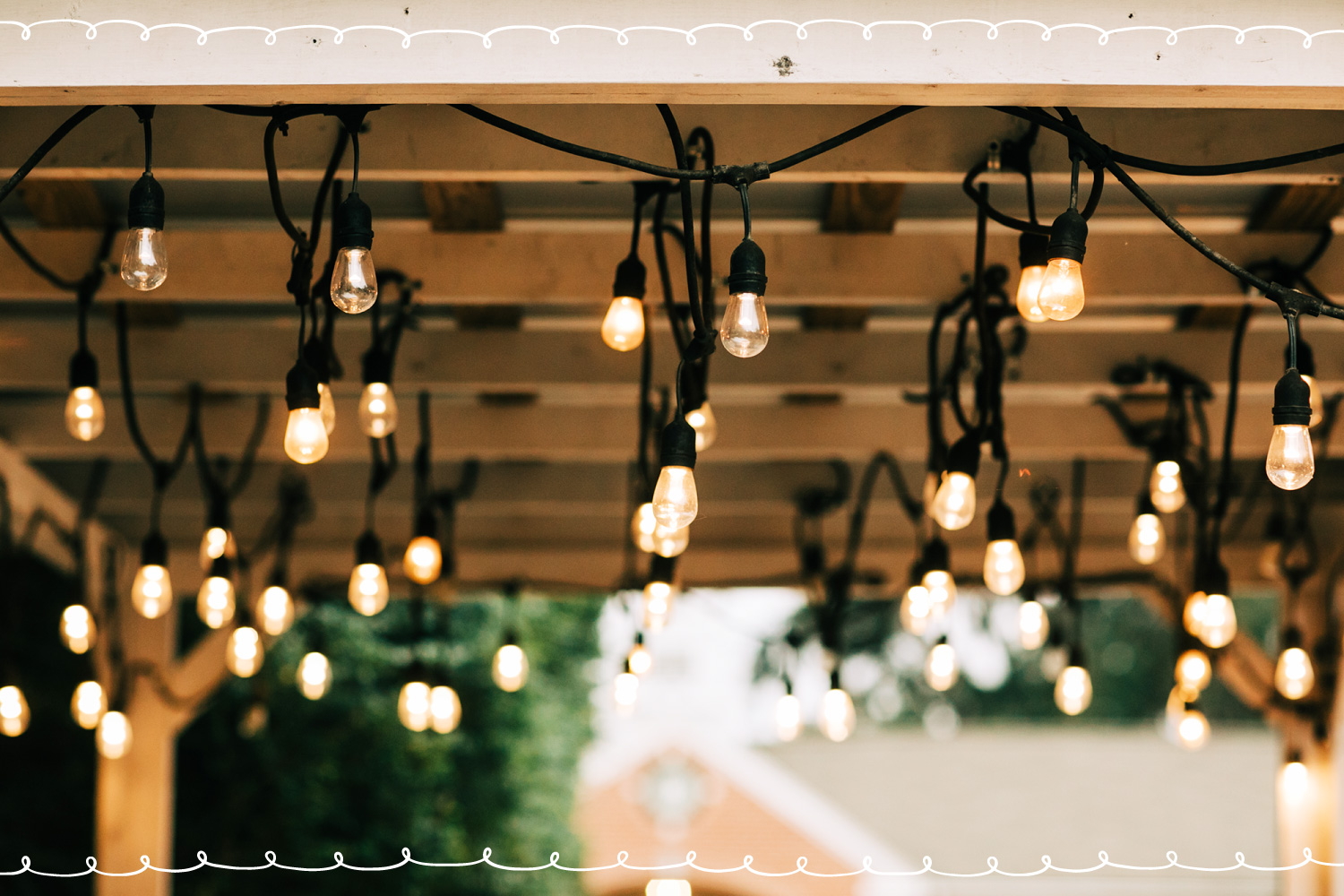 stringlights hanging from pergola outside
