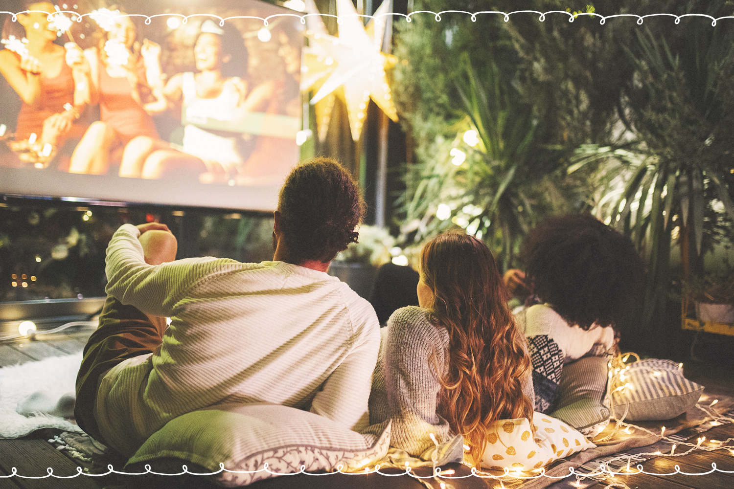 friends chilling in backyard movie theater