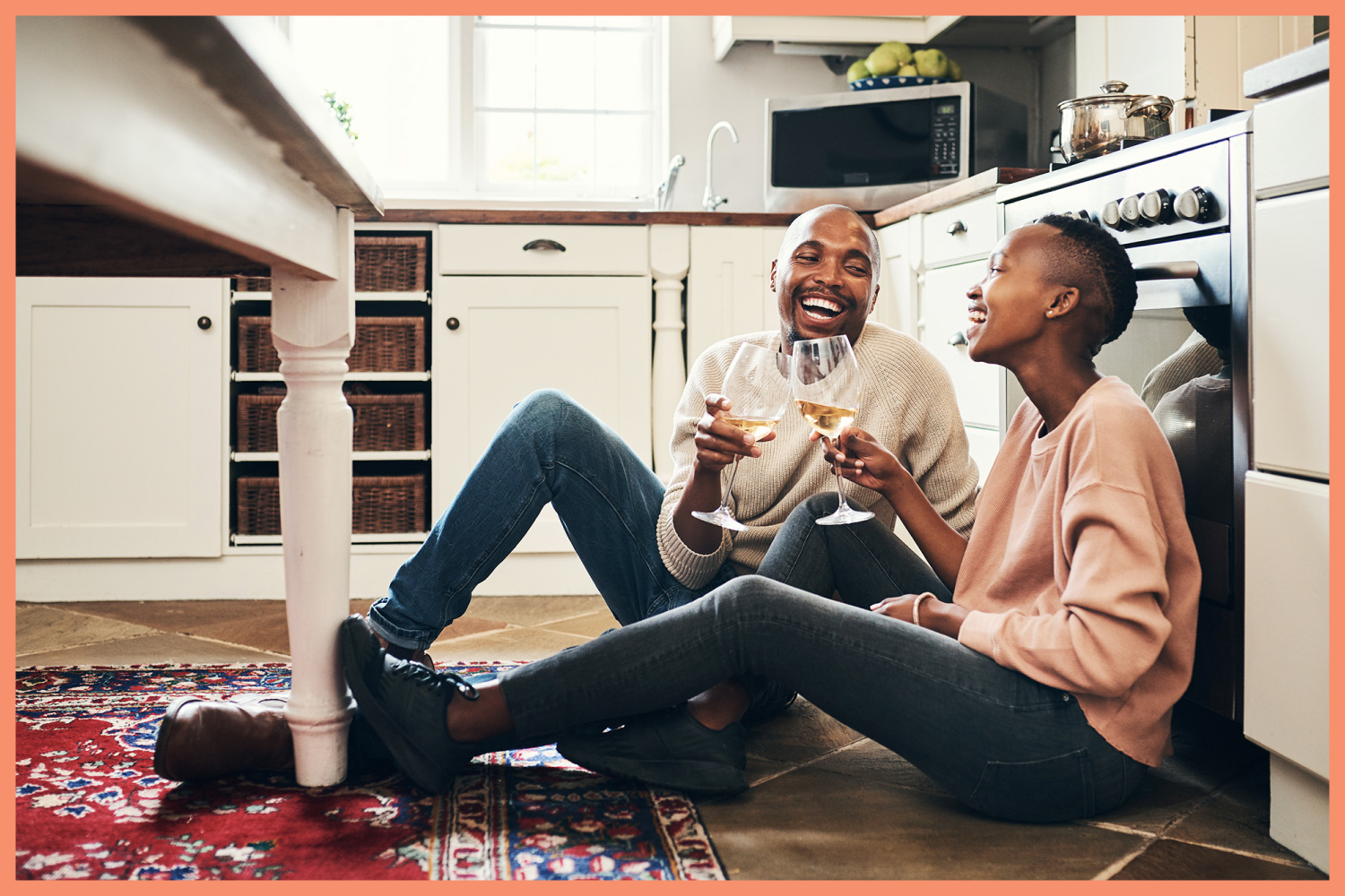 couple drinking wine in a kitchen
