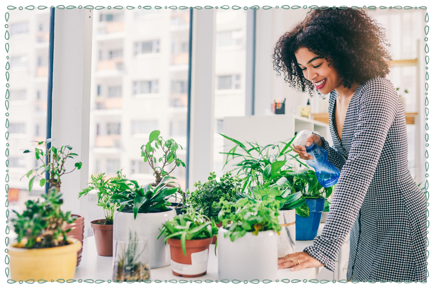 smiling woman tending her indoor plant collection