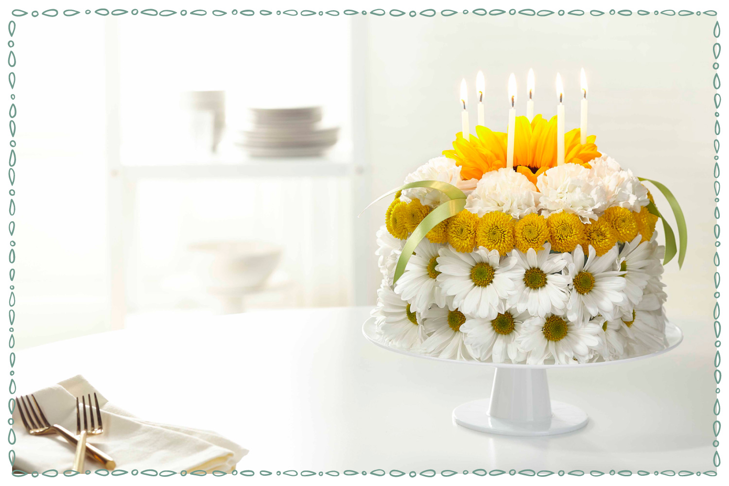 a white and yellow flower cake on white surface with white candles
