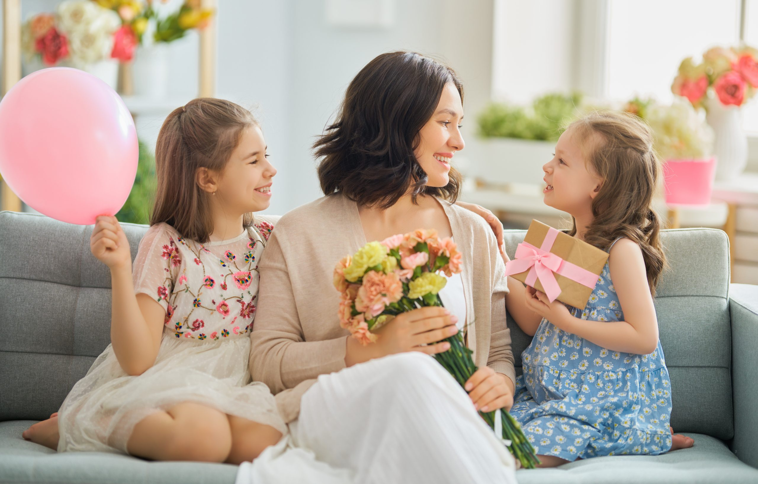Mother with daughters and flowers