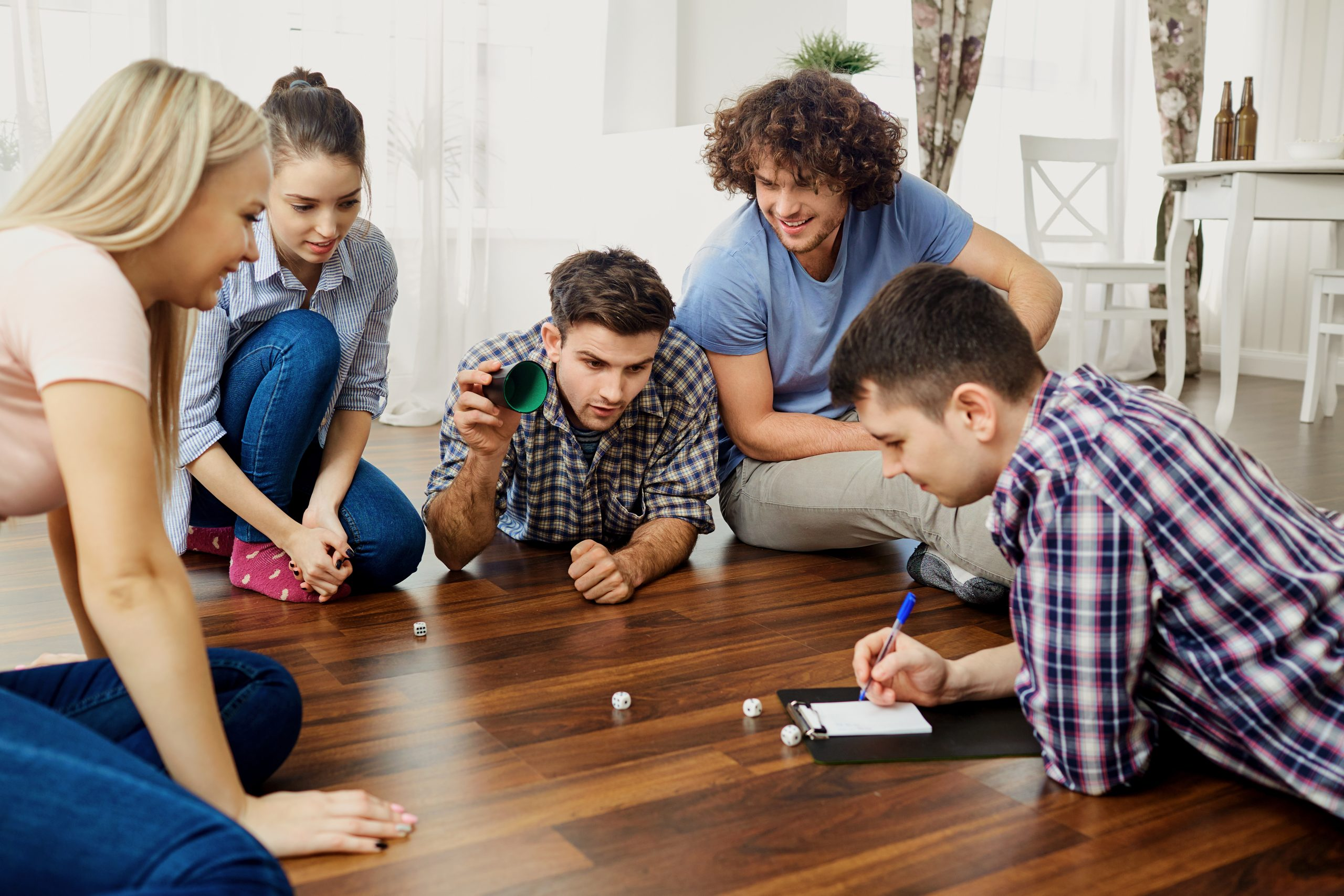 Group of friends playing a dice game