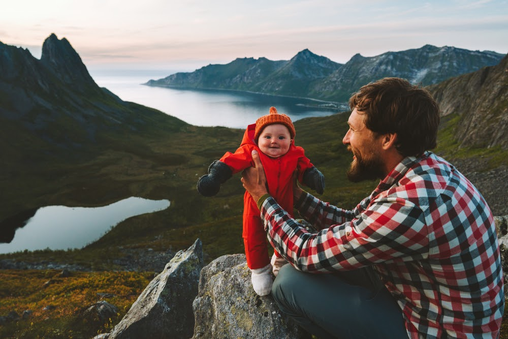 Father hiking with infant baby